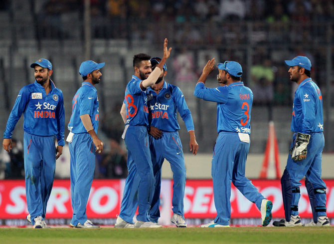 Indian players celebrate the wicket