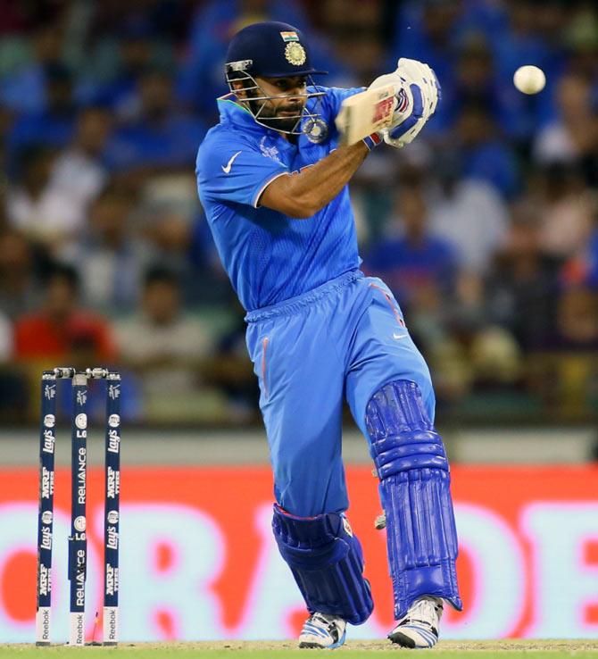 Rediff Sports - Cricket, Indian hockey, Tennis, Football, Chess, Golf - Stats: Kohli equals Tendulkar's record, Dhoni's sixes