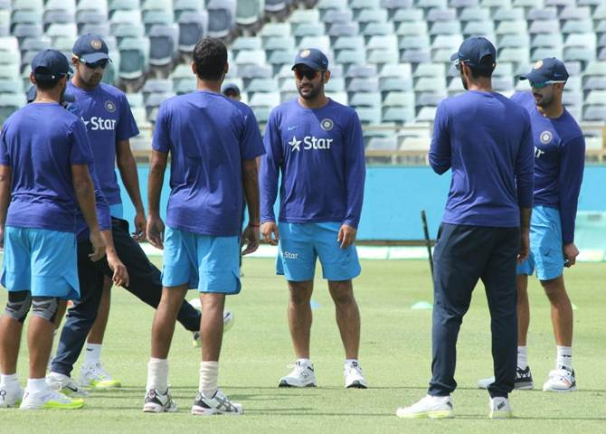 Mahendra Singh Dhoni addresses his players during Monday's practice session at the WACA