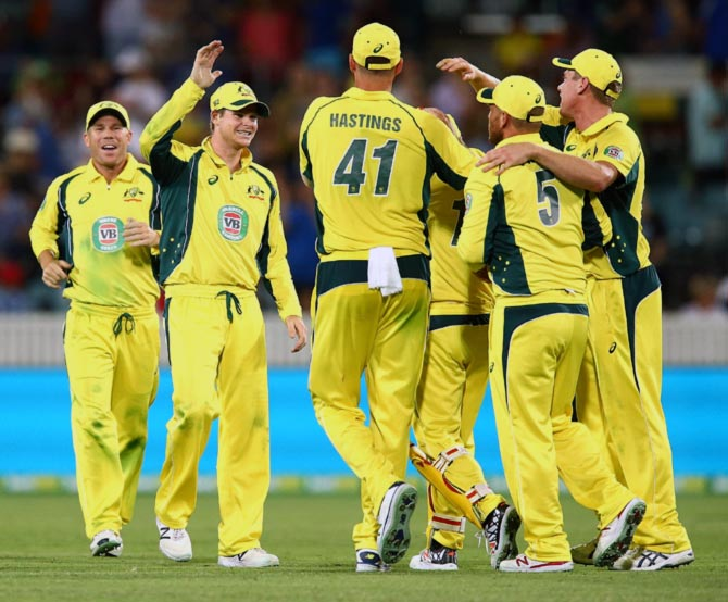The Australian team celebrates winning