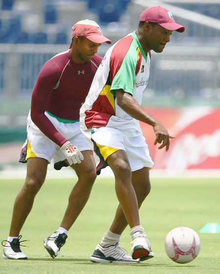 West Indies' Brian Lara plays football with teammate Shivnarine Chanderpaul during a team training session at the Kensington Oval on April 20, 2007 in Bridgetown, Barbados