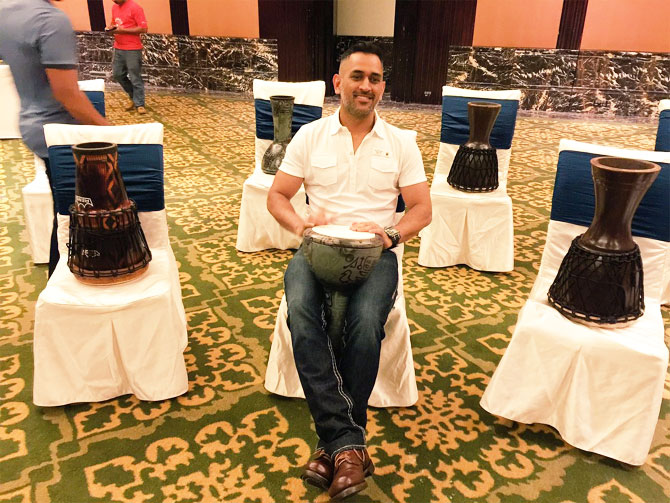 Rediff Cricket - Indian cricket - Team India's bonding session: Dhoni, Rahane turn percussionists
