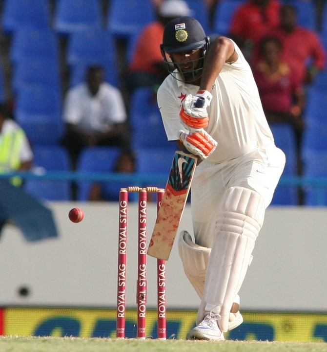 Rediff Cricket - Indian cricket - Ashwin completes the double of 1000 runs and 100 wickets in Tests