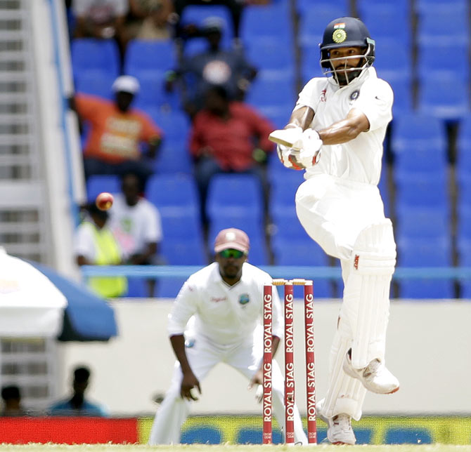 Rediff Cricket - Indian cricket - How captain Kohli's backing got Dhawan back on track