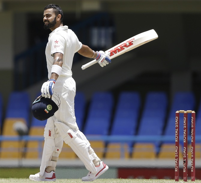 Rediff Cricket - Indian cricket - PHOTOS: Kohli makes history as India take command