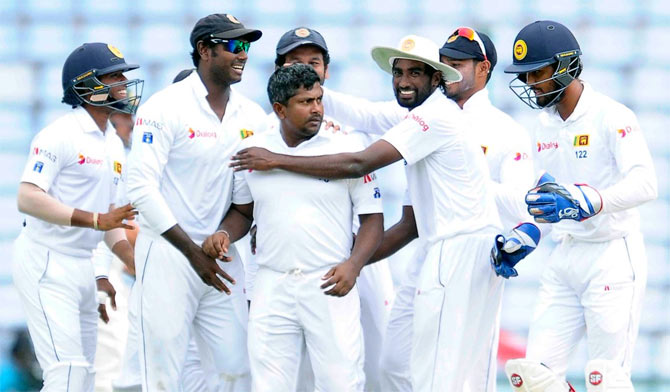 Sri Lanka players celebrate win over Australia