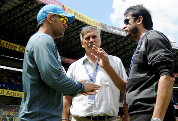 Sandeep Patil, right, with Mahendra Singh Dhoni, left, and Roger Binny, centre