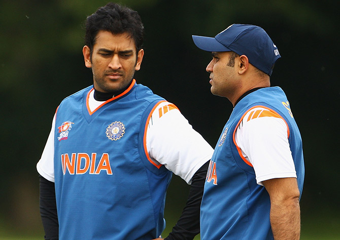 MS Dhoni, captain of India, talks to Virender Sehwag during a nets session