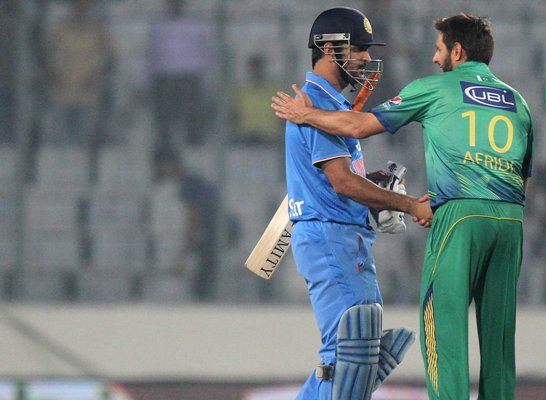 India's captain Mahendra Singh Dhoni shakes hands with his Pakistan counterpart Shahid Afridi at the end of their Asia Cup match