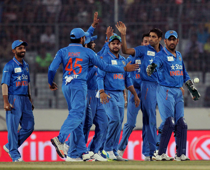 India's Ashish Nehra celebrates with teammates