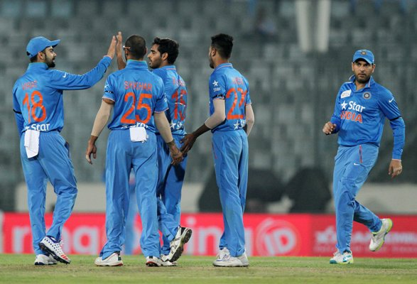 Indian players celebrate after the fall of a UAE wicket during their Asia Cup match in Mirpur