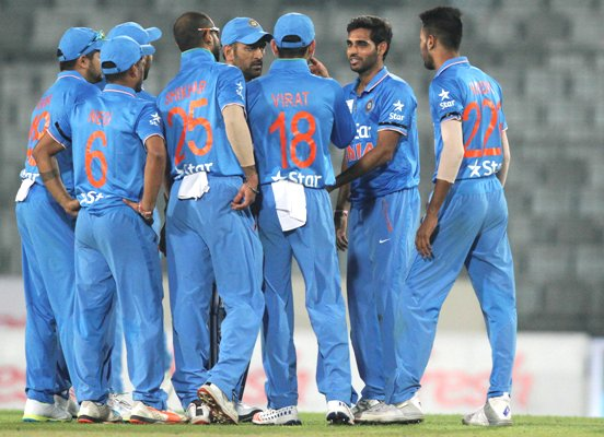 Indian players celebrate the wicket of United Arab Emirates' opener Swapnil Patil