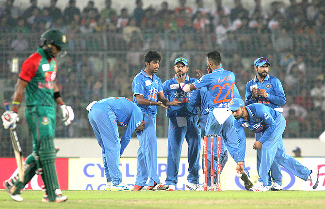 India players celebrate the wicket of Bangladesh's Soumya Sarkar during their Asia Cup match on February 24