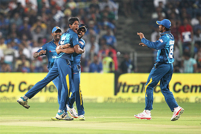 Sri Lanka pacer Kasun Rajitha celebrates after dismissing Rohit Sharma in the first T20 International against India in Pune last month
