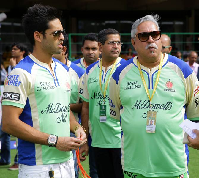 Vijay Mallya, right, with his son Siddhartha at an IPL match in 2013