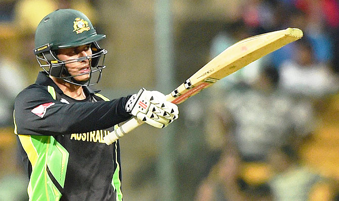 Australian batsman Usman Khawaja celebrates his fifty against Bangladesh during their ICC World T20 Super 10s Group 2 match at Chinnaswamy Stadium in Bengaluru on Monday