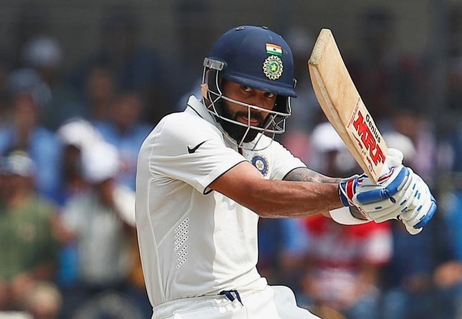 Rediff Sports - Cricket, Indian hockey, Tennis, Football, Chess, Golf - Warm-up, Day 2: Kohli hits 50 as India score 312-9 in drawn tie