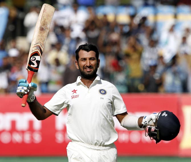 A delighted Cheteshwar Pujara after completing his century against England on his home ground in Rajkot. Photograph: BCCI