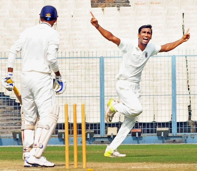 Maharashtra bowler Anupam Sanklecha celebrates after taking wicket of Vidarbha batsman Akshay Wakhare (left) during their Ranji Trophy match at Eden Gardens in Kolkata on Tuesday