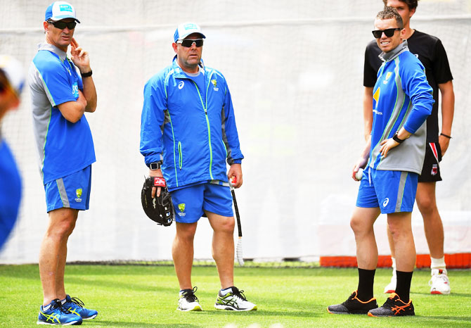 Australia's batting coach Greame Hick chats with coach Darren Lehmann and pacer Peter Siddle during an Australian nets session at Adelaide Oval in Adelaide on Monday