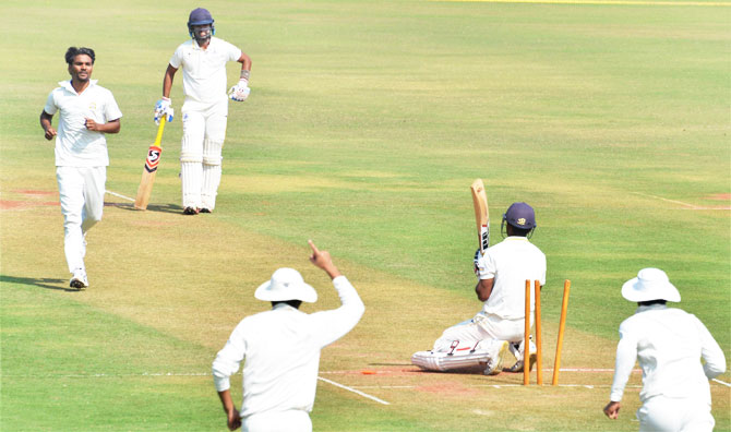 Tamil Nadu captain Abhinav Mukund is dismissed by Punjab bowler Sandeep Sharma during the Ranji Trophy cricket match at VCA stadium in Nagpur on Tuesday