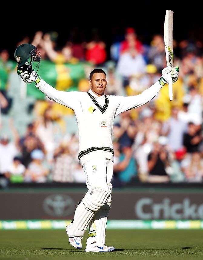 PHOTOS: Khawaja's unbeaten century gives Australia the ...