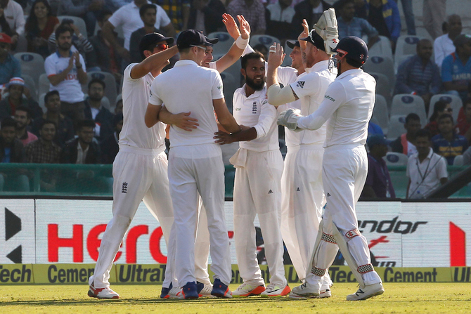 England's Adil Rashid celebrates the wicket of Cheteshwar Pujara on day 2 of the third Test in Mohali