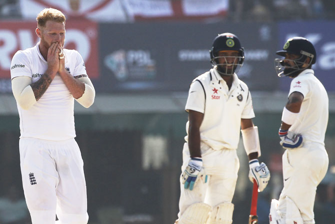 Ben Stokes gestures as Cheteshwar Pujara and Virat Kohli bat on Day 2 on Sunday