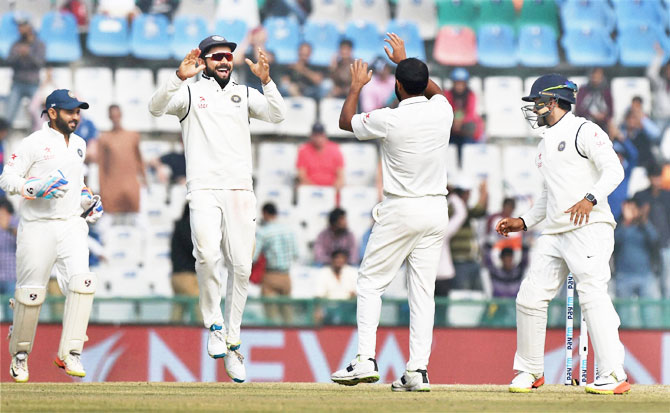 India captain Virat Kohli celebrates with Mohammed Shami after dismissing Chris Woakes on the fourth day of the third Test in Mohali on Tuesday