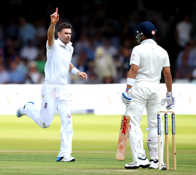 : England fast bowler James Anderson, left, celebrates after taking the wicket of Virat Kohli during the second Test at Lord's on July 17, 2014