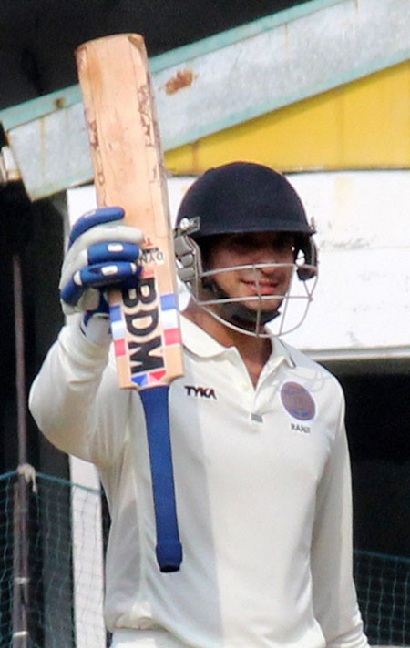 Hyderabad batsman Mehdi Hasan celebrates after scoring a half-century against Goa in the Ranji Trophy match at VCA stadium in Nagpur on Saturday