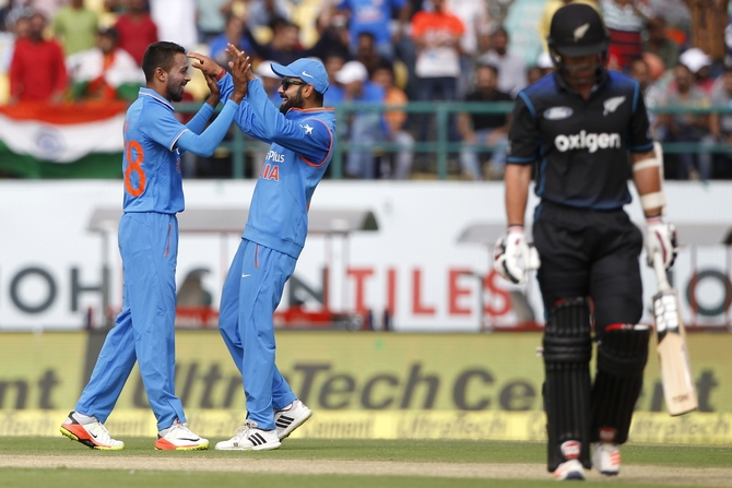 India's Hardik Pandya celebrates with Virat Kohli