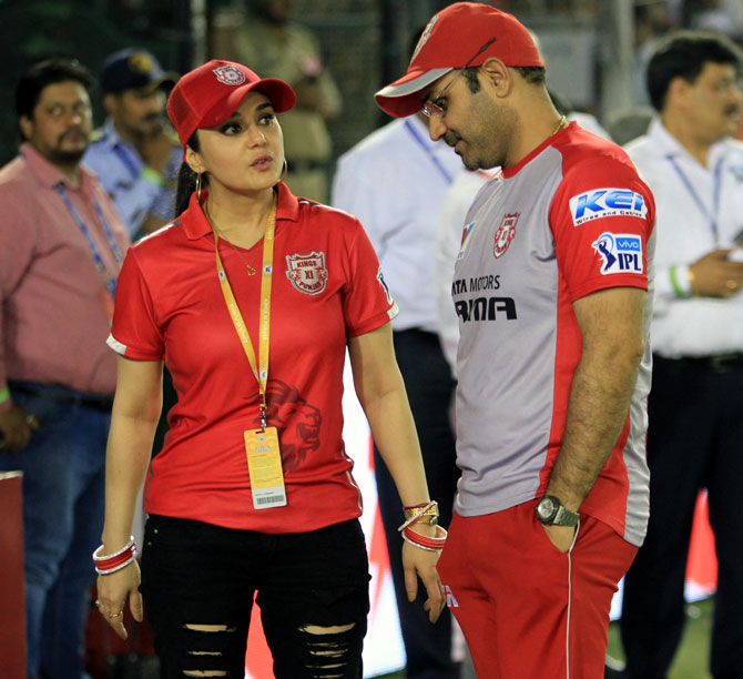 Kings XI Punjab director of cricket operations Virender Sehwag, right, with co-owner Preity Zinta