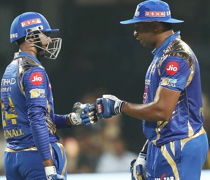 IMAGE: Krunal Pandya of the Mumbai Indians and Kieron Pollard celebrate. Photograph: BCCI