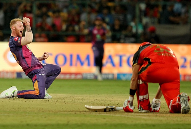 The Rising Pune Supergiant's Ben Stokes celebrates the wicket of Royal Challengers Bangalore's Shane Watson during their Indian Premier League match in Bengaluru, on Sunday, April 16