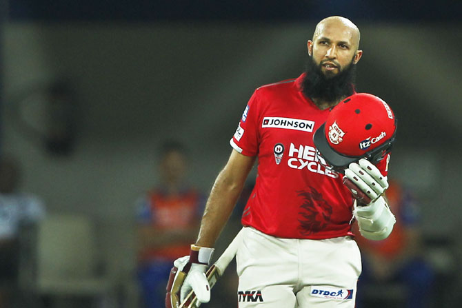 Kings XI Punjab's Hashim Amla celebrates on scoring his century against Mumbai Indians, his first IPL and T20 ton, in Indore on Thursday