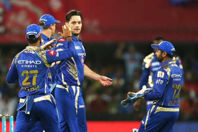Mumbai Indians players congratulate Mitchell McClenaghan after dismissing King's XI Punjab's Shaun Marsh