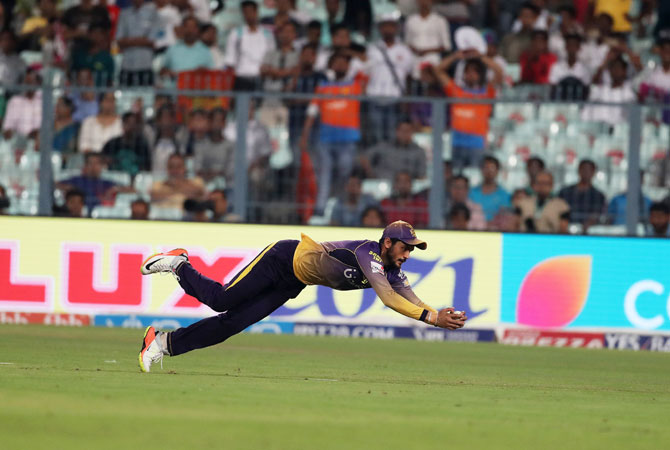KKR's Manish Pandey takes a fine catch to send Suresh Raina back into the dug out