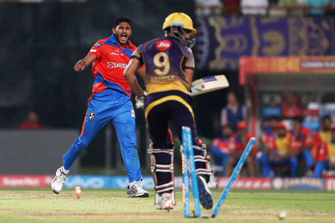 Gujarat Lions' Basil Thampi celebrates after cleaning up KKR's Manish Pandey