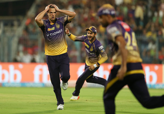 Kolkata Knight Riders' Nathan Coulter-Nile reacts as the catch is taken to dismiss Royal Challengers Bangalore's AB de Villiers