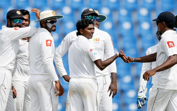 Lanka's chinaman bowler Lakshan Sandakan, centre, will be crucial to their chances