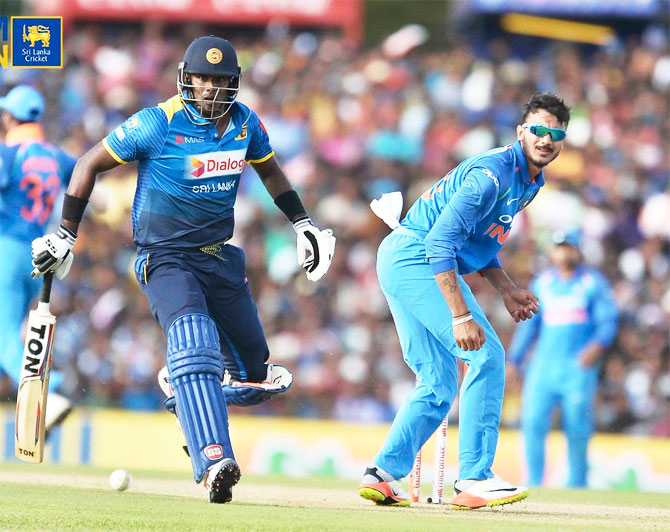 Axar Patel and Angelo Mathews in action