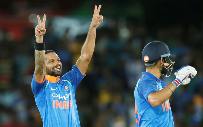 Rediff Sports - Cricket, Indian hockey, Tennis, Football, Chess, Golf - PHOTOS: Dhawan strikes century as India cruise to 9-wkt win