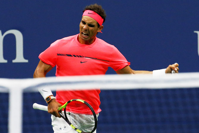Rafael Nadal celebrates a point against Dusan Lajovic on Tuesday