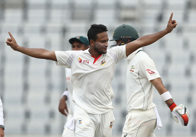 Bangladesh's hakib Al Hasan celebrates taking the wicket of Australia's Matthew Renshaw during the 1st Test in Mirpur, Dhaka