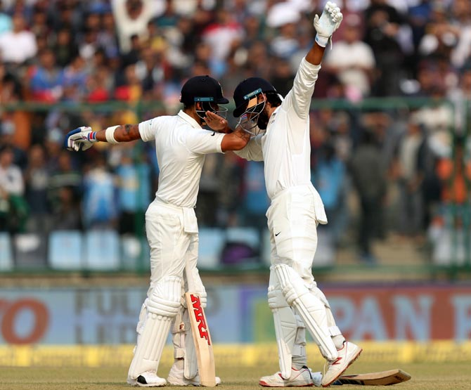 Murali Vijay, right, celebrates his century with captain Virat Kohli as they do the 'Dab' dance on Day 1 of the 3rd Test in New Delhi on Saturday