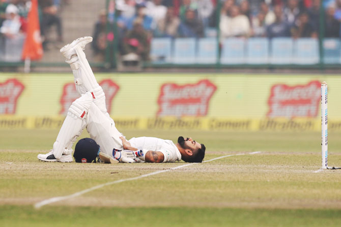 India captain Virat Kohli stretches during the first interruption of play on Day 2 of the 3rd Test against Sri Lanka in New Delhi on Sunday