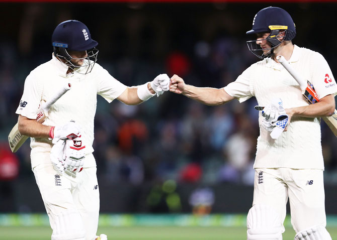 England's Joe Root (left) and Chris Woakes leave the ground at stumps on Day 4 of the second Ashes Test against Australia at Adelaide Oval in Adelaide on Tuesday
