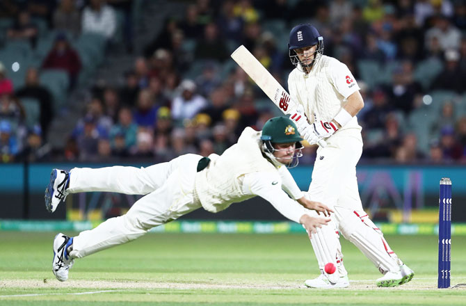 England captain Joe Root bats as Australia's Cameron Bancroft attempts to field the ball