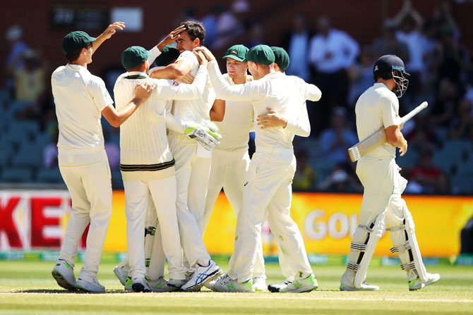 Australia players celebrate victory after Mitchell Starc had England's Jonny Bairstow clean bowled on Day 5 of the 2nd Ashes Test match at Adelaide Oval in Adelaide on Wednesday